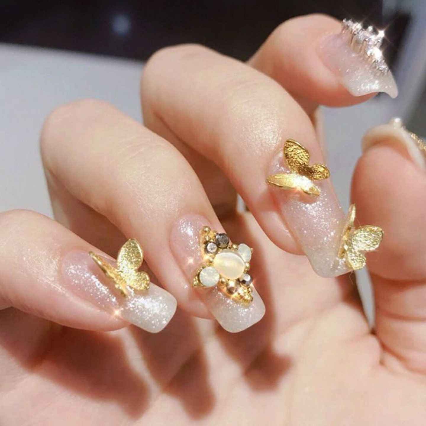 Gold 3D butterfly nails