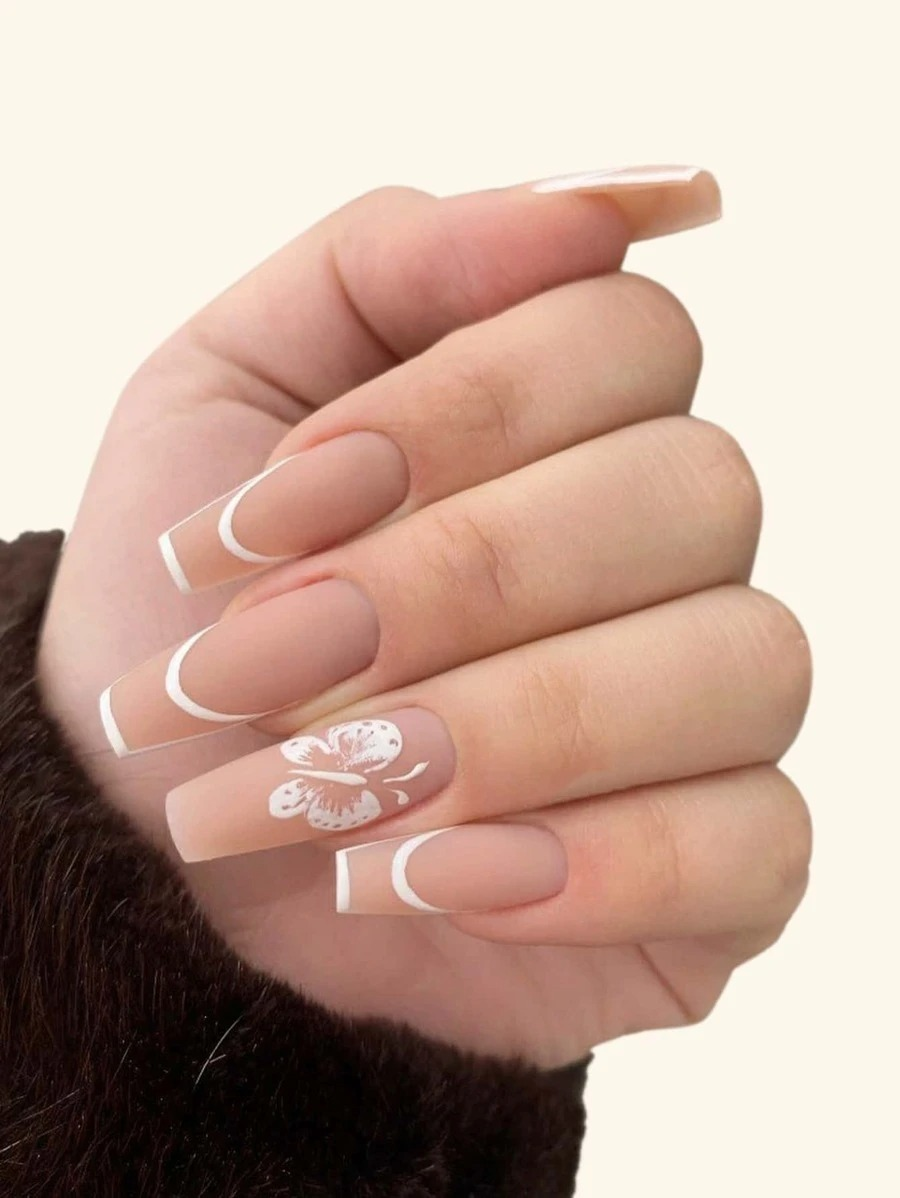 Minimalist French tip nails with butterfly nail art
