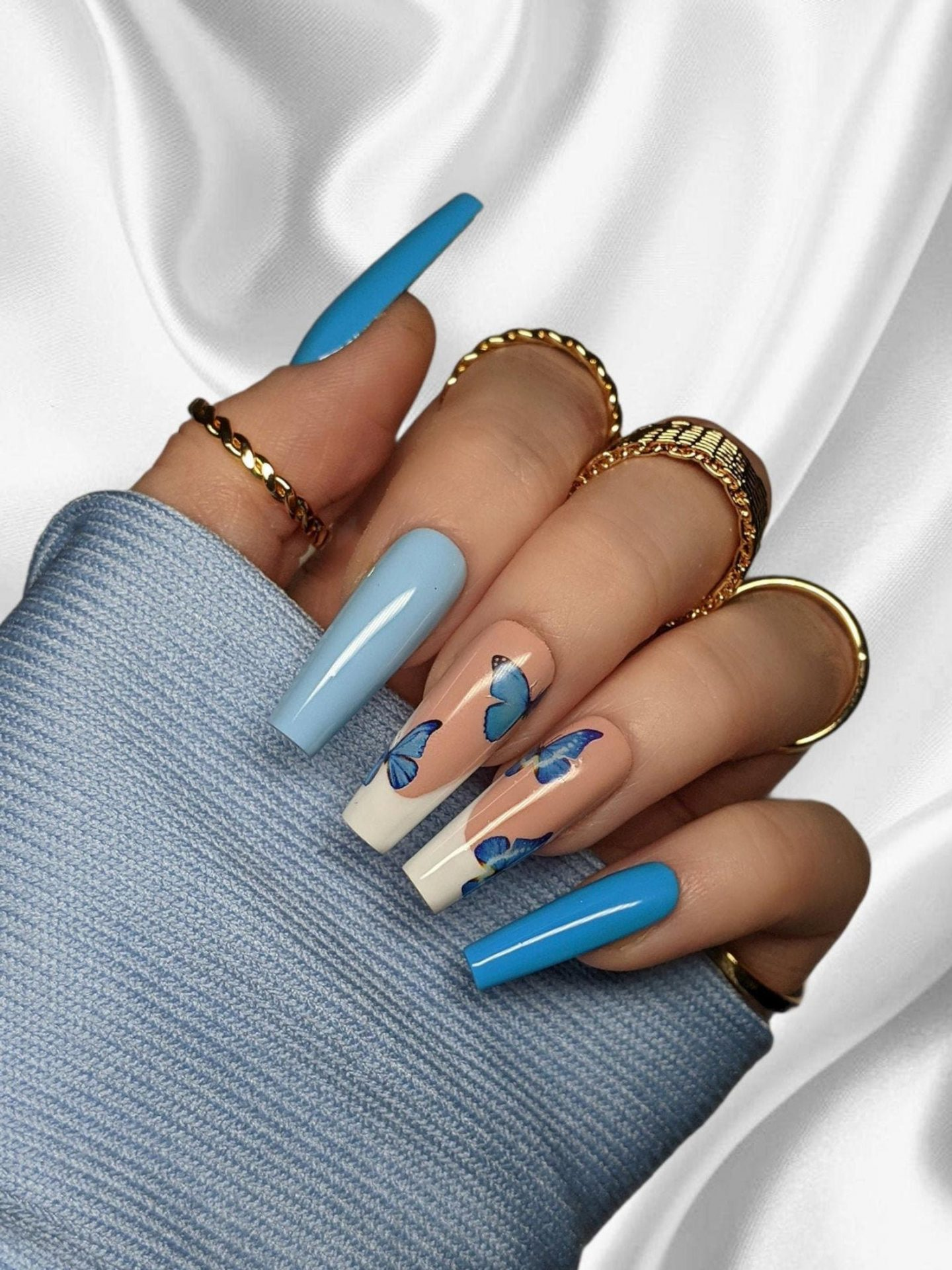 Baby blue butterfly nails
