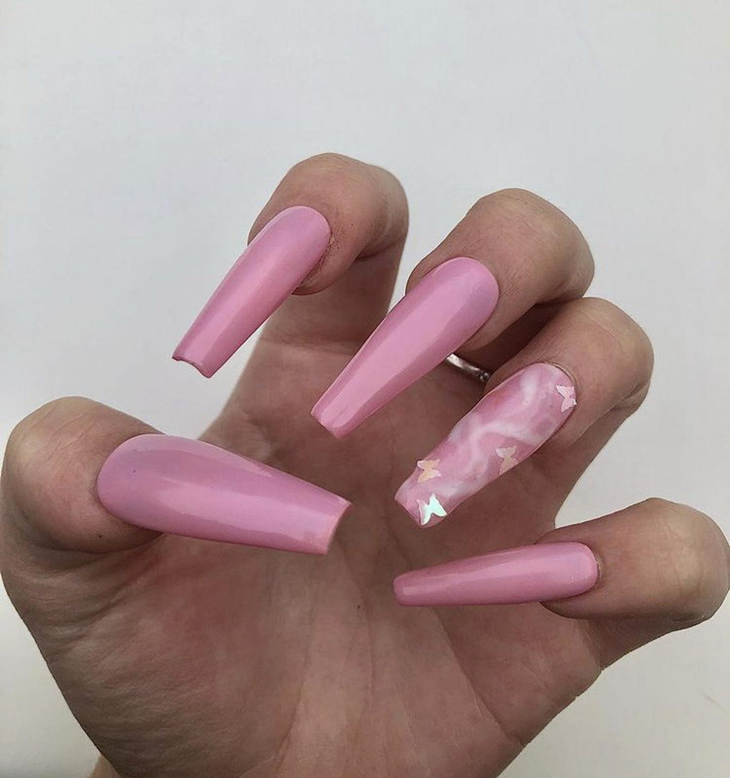 Pink butterfly nails in acrylic coffin shape