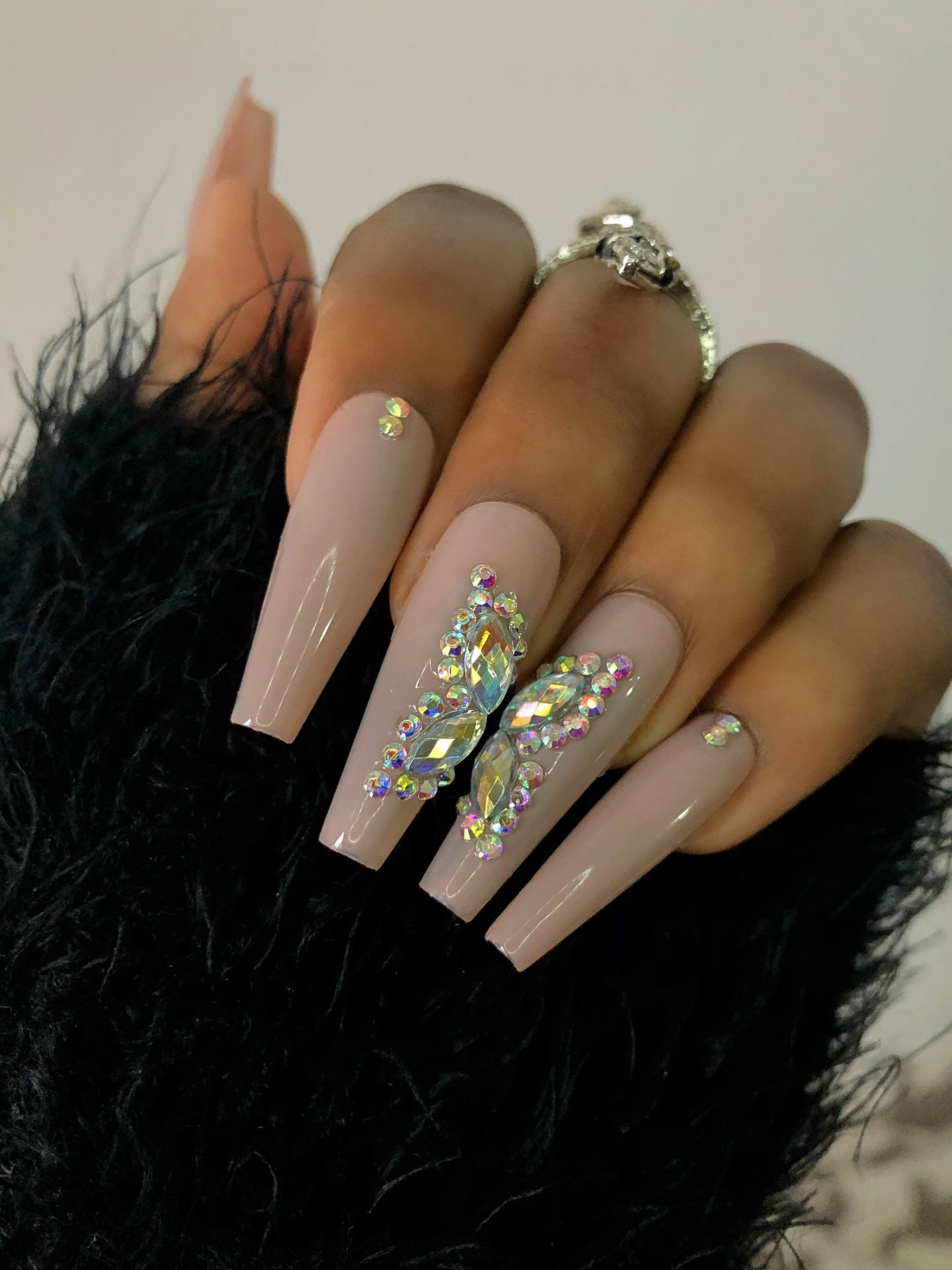 Taupe acrylic coffin nails with butterfly nail art effect and rhinestones