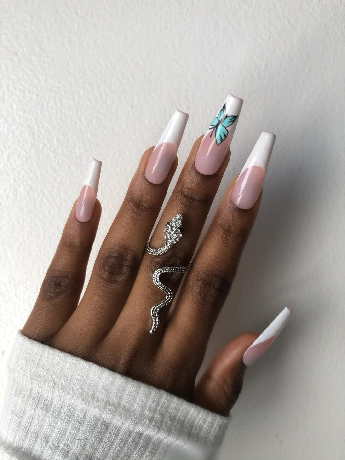 Acrylic coffin French tip nails with butterfly nail art