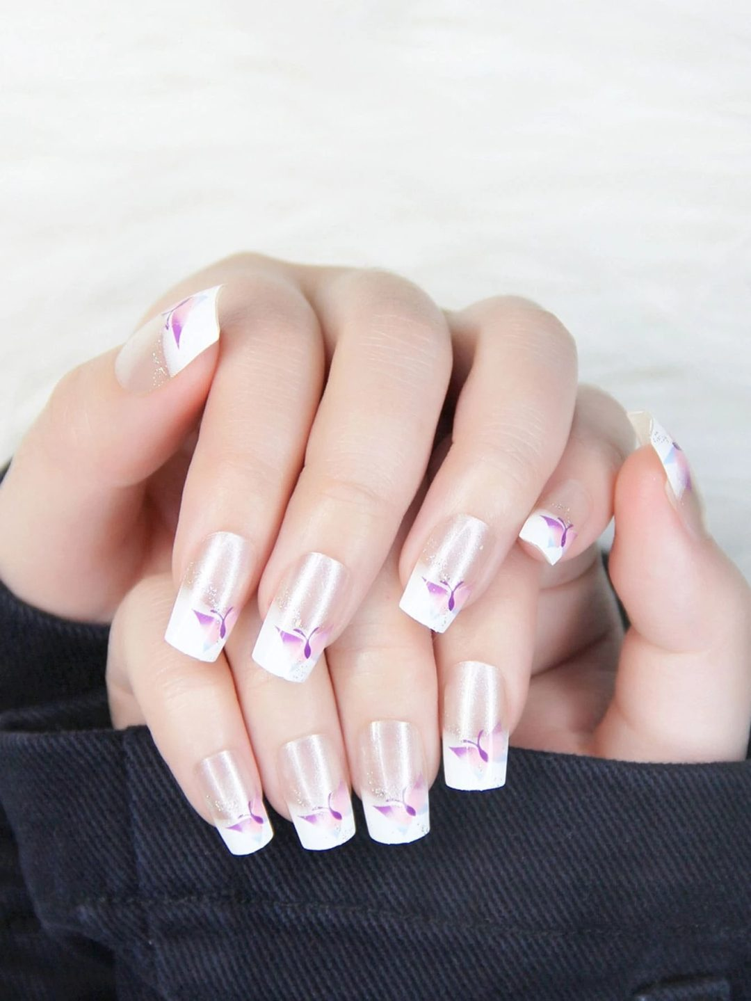 French tip nails with pink butterfly nail art