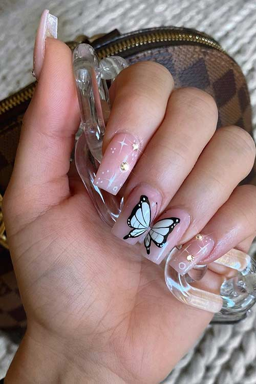 Cute light pink butterfly nails