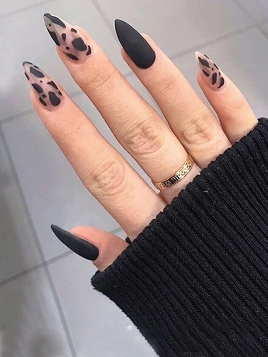 Matte black cow print nails