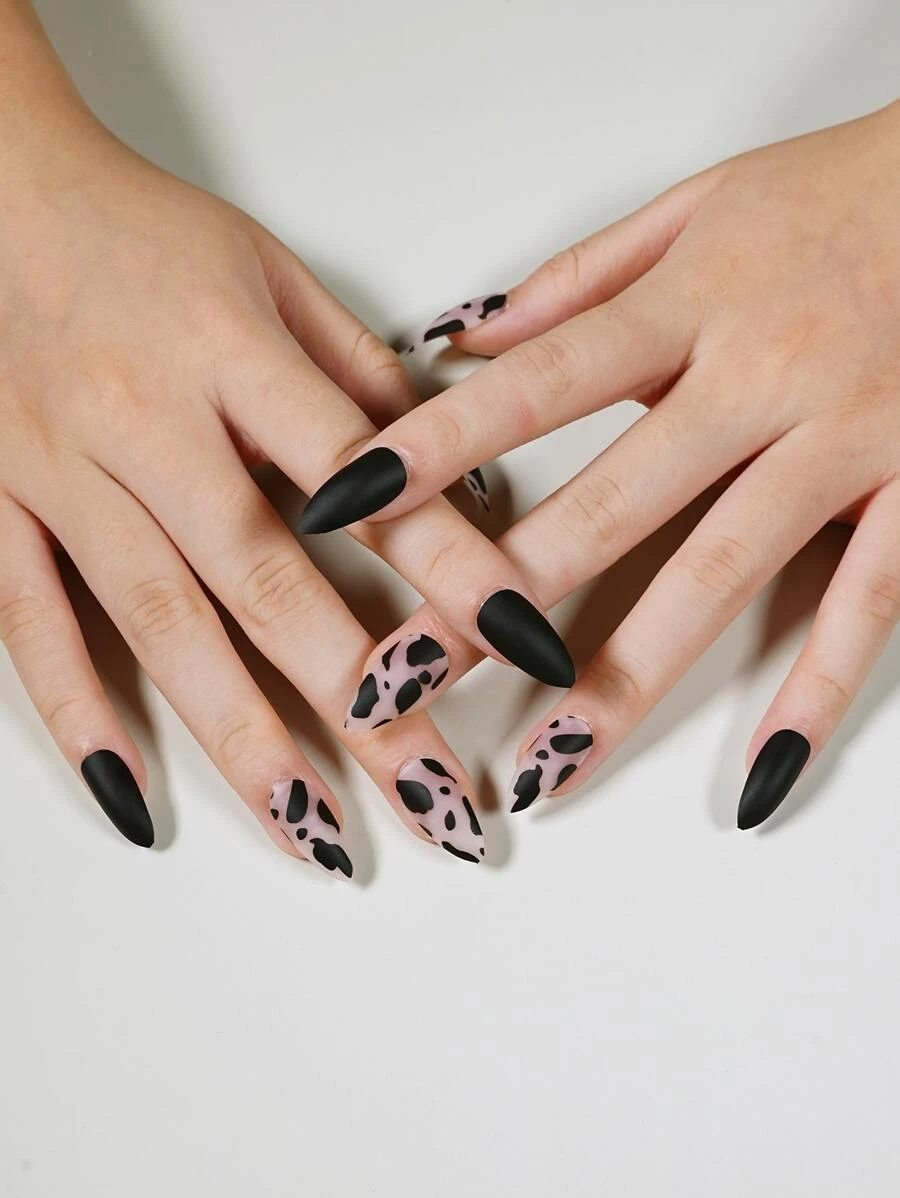 Matte black cow print and abstract nails