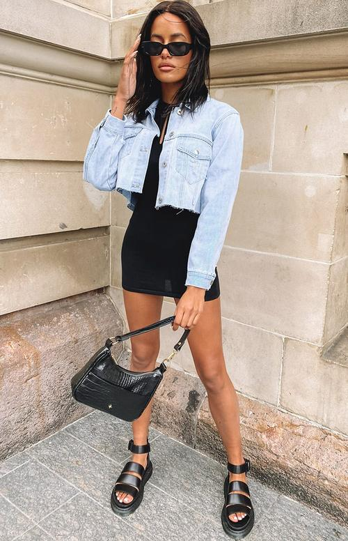 90s aesthetic outfit with black dress and cropped jacket