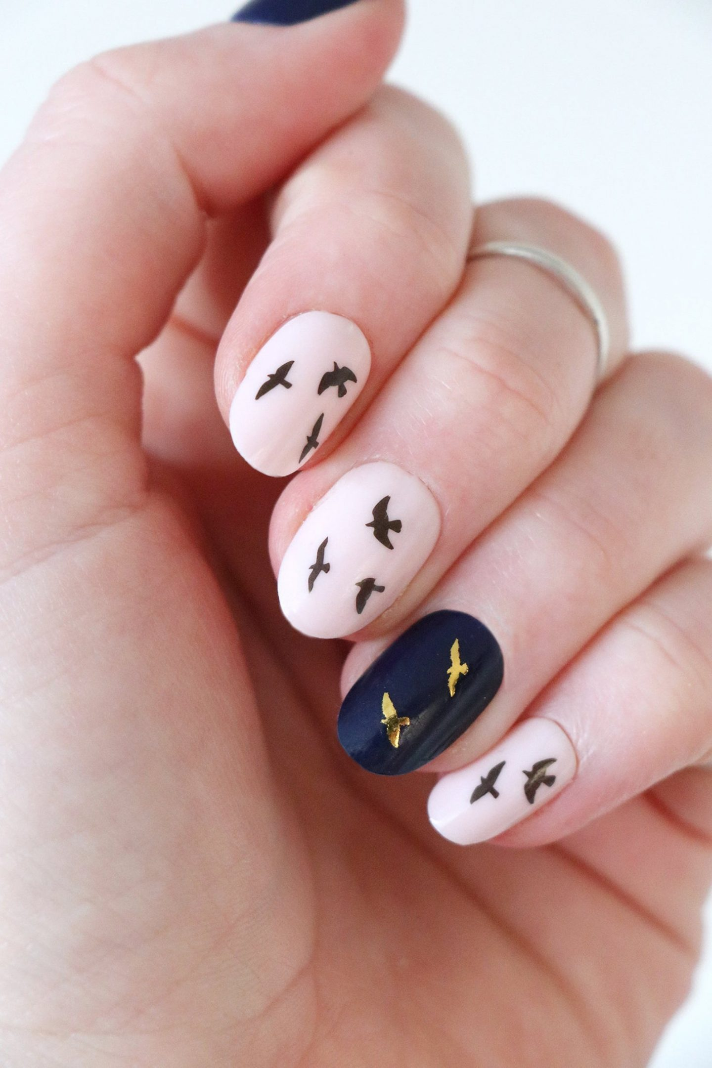 Cute light pink and navy blue short nails with nail art