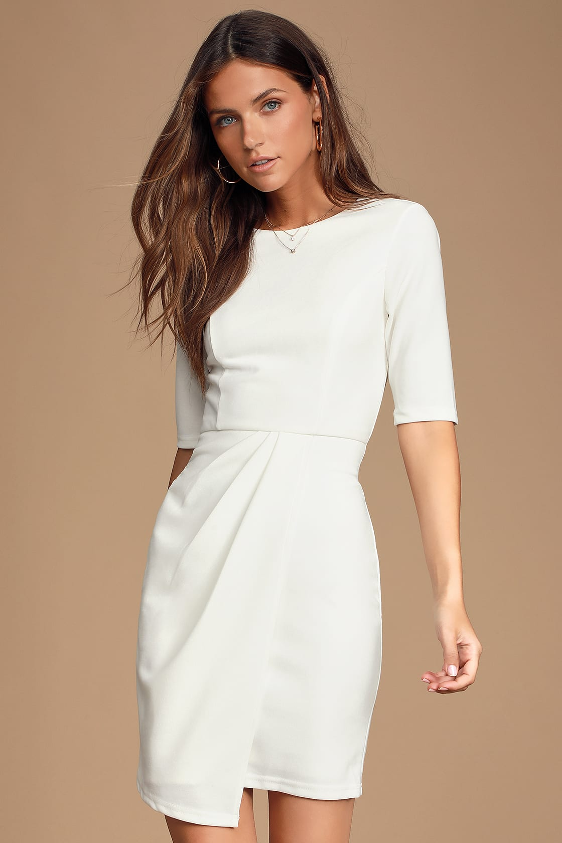 Sophisticated white graduation dress with sleeves