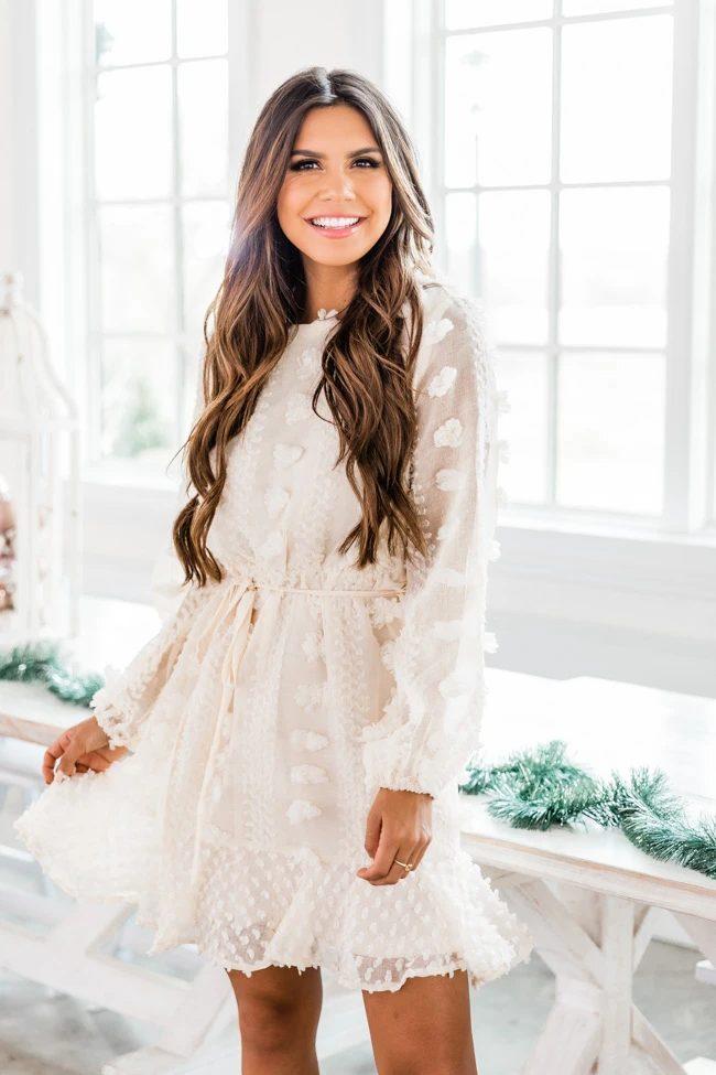Feminine cream dress with sleeves and ruffles