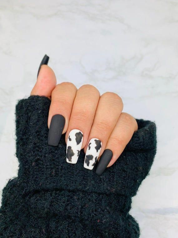Matte black and white cow nails
