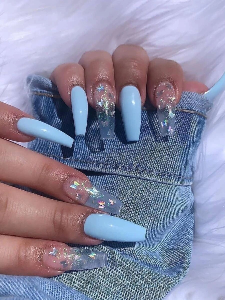 Pastel blue nails with butterfly nail art