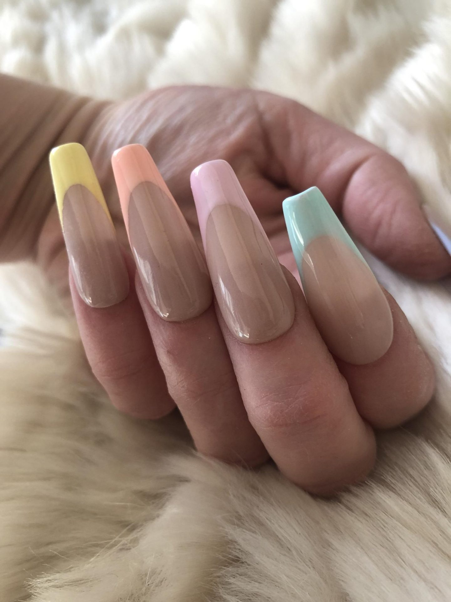 Pastel French tip nails with pink, blue, orange and yellow