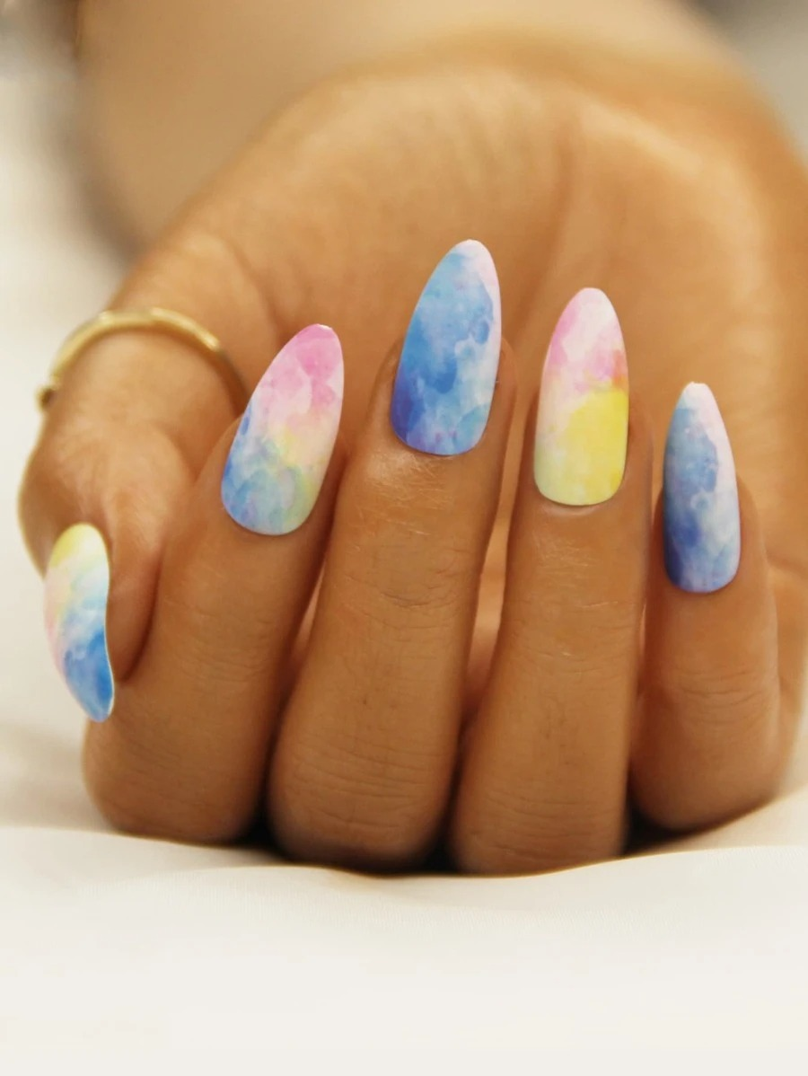 Tie dye nail art with blue, pink and yellow