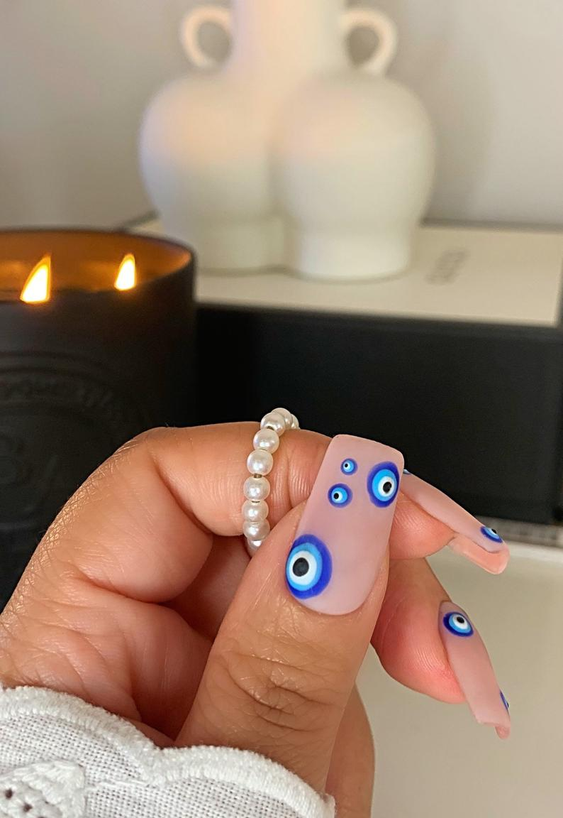 Neutral, nude and blue evil eye nails