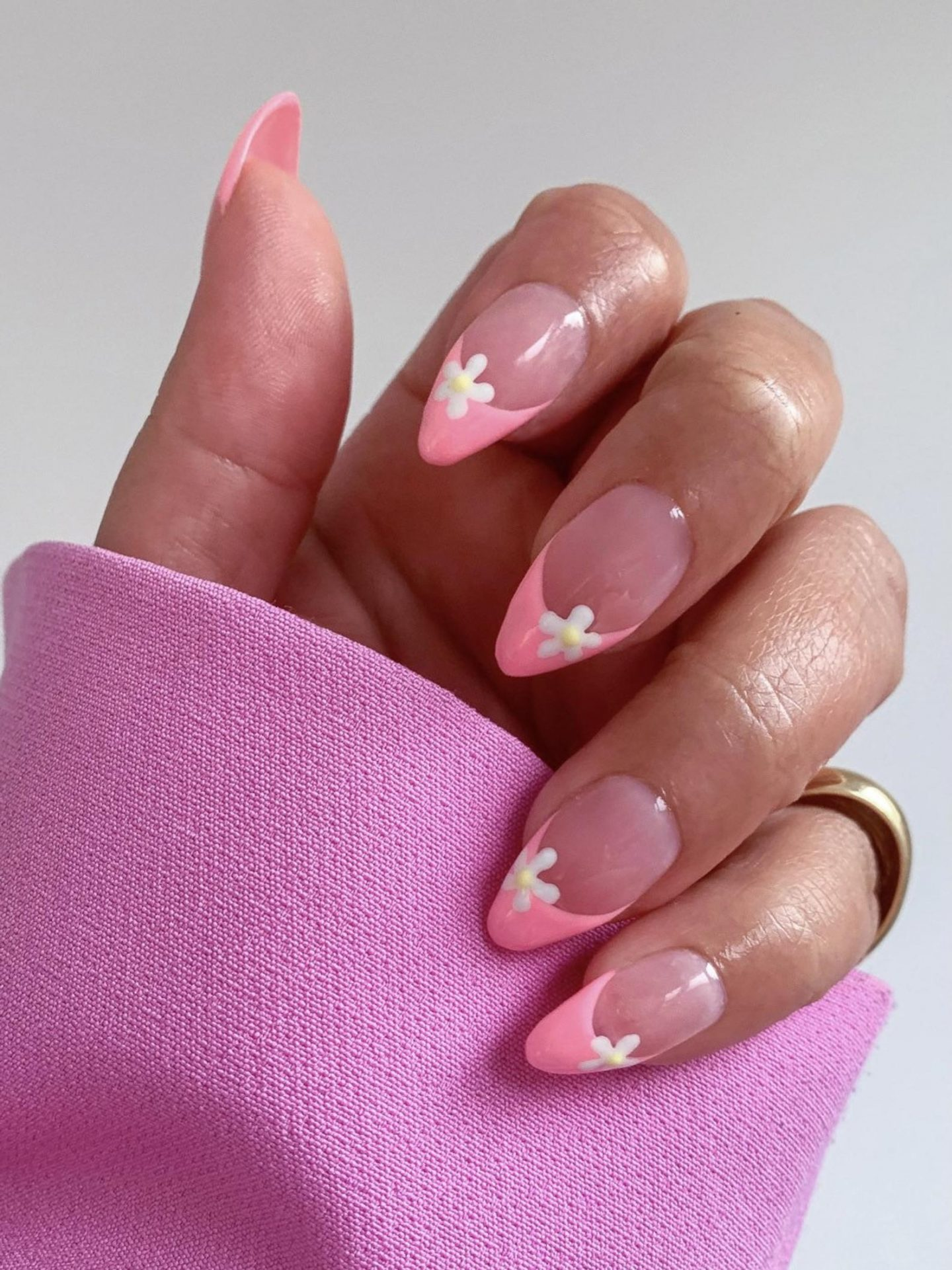 Pink French tip press on nails with flower nail art