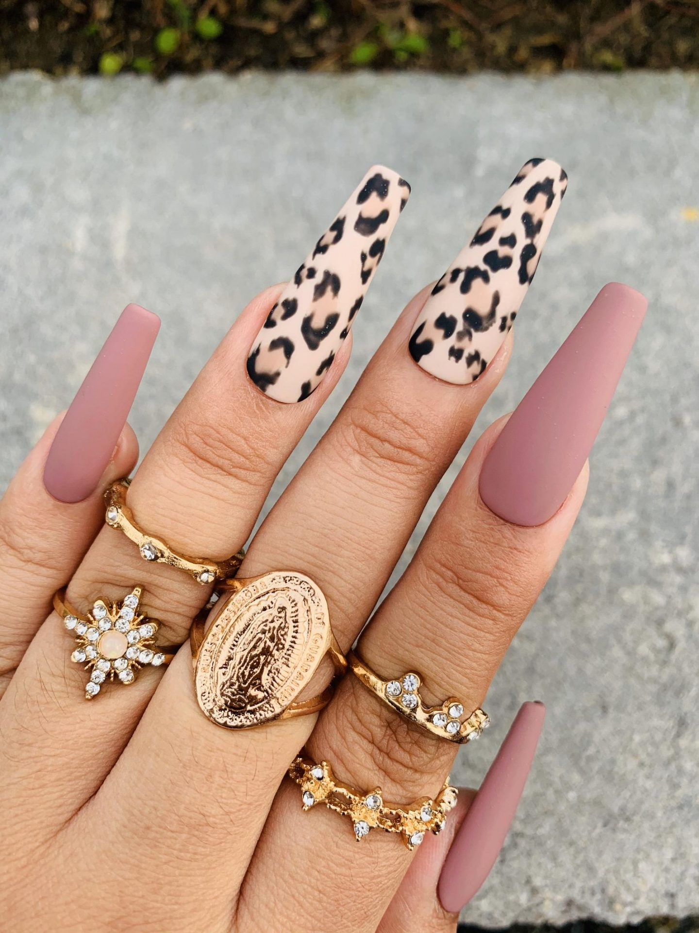 Matte pink press on nails in coffin shape with leopard print