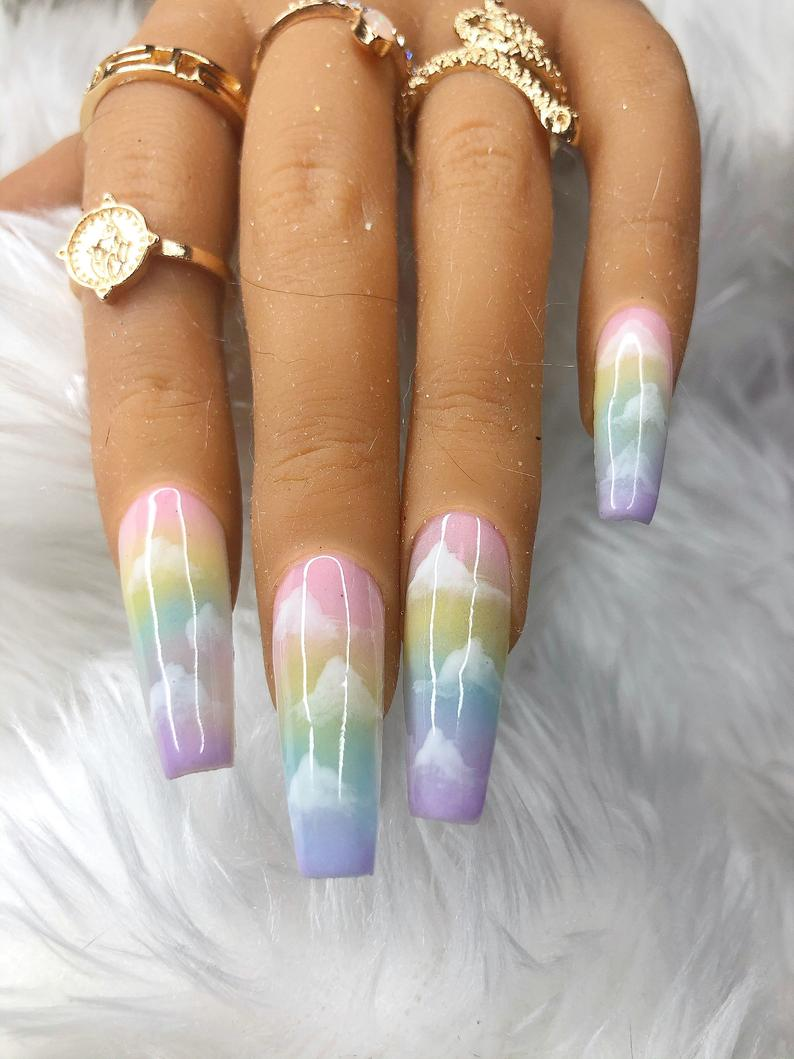 Cute pastel nails with pastel rainbow ombre design and clouds