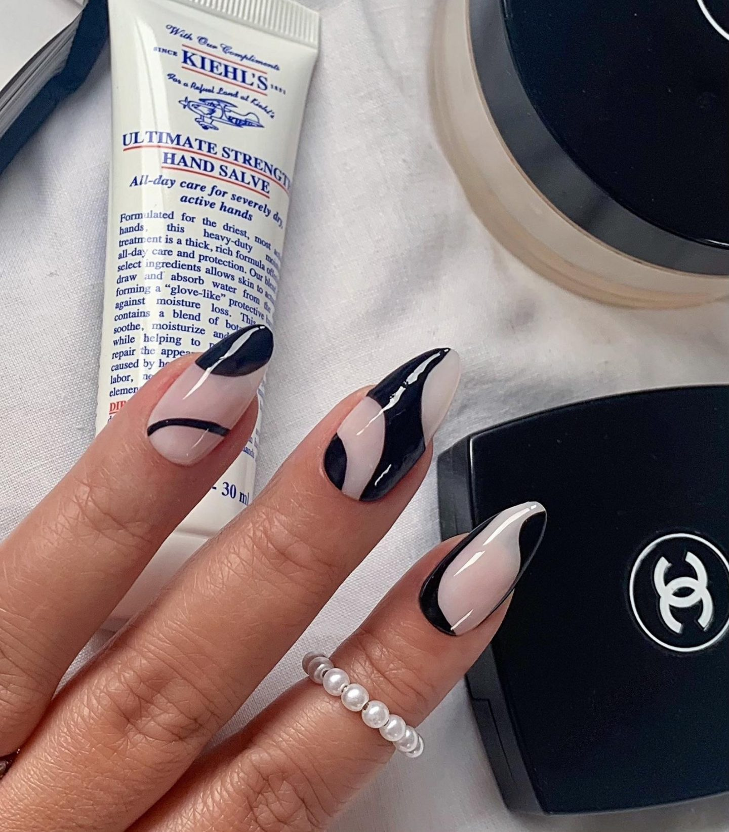 Abstract nails with black swirls and lines