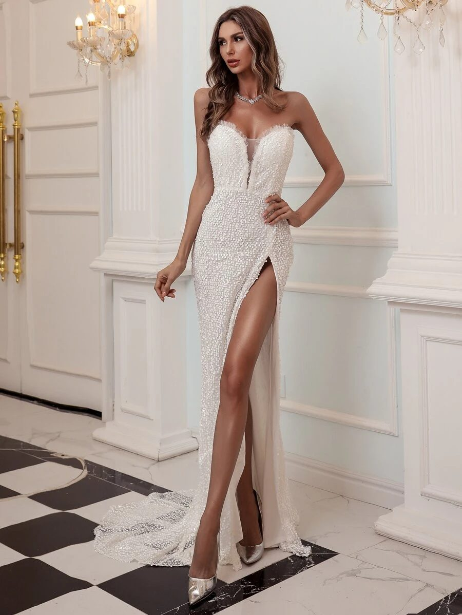 White sequin bandeau prom dress with high slit