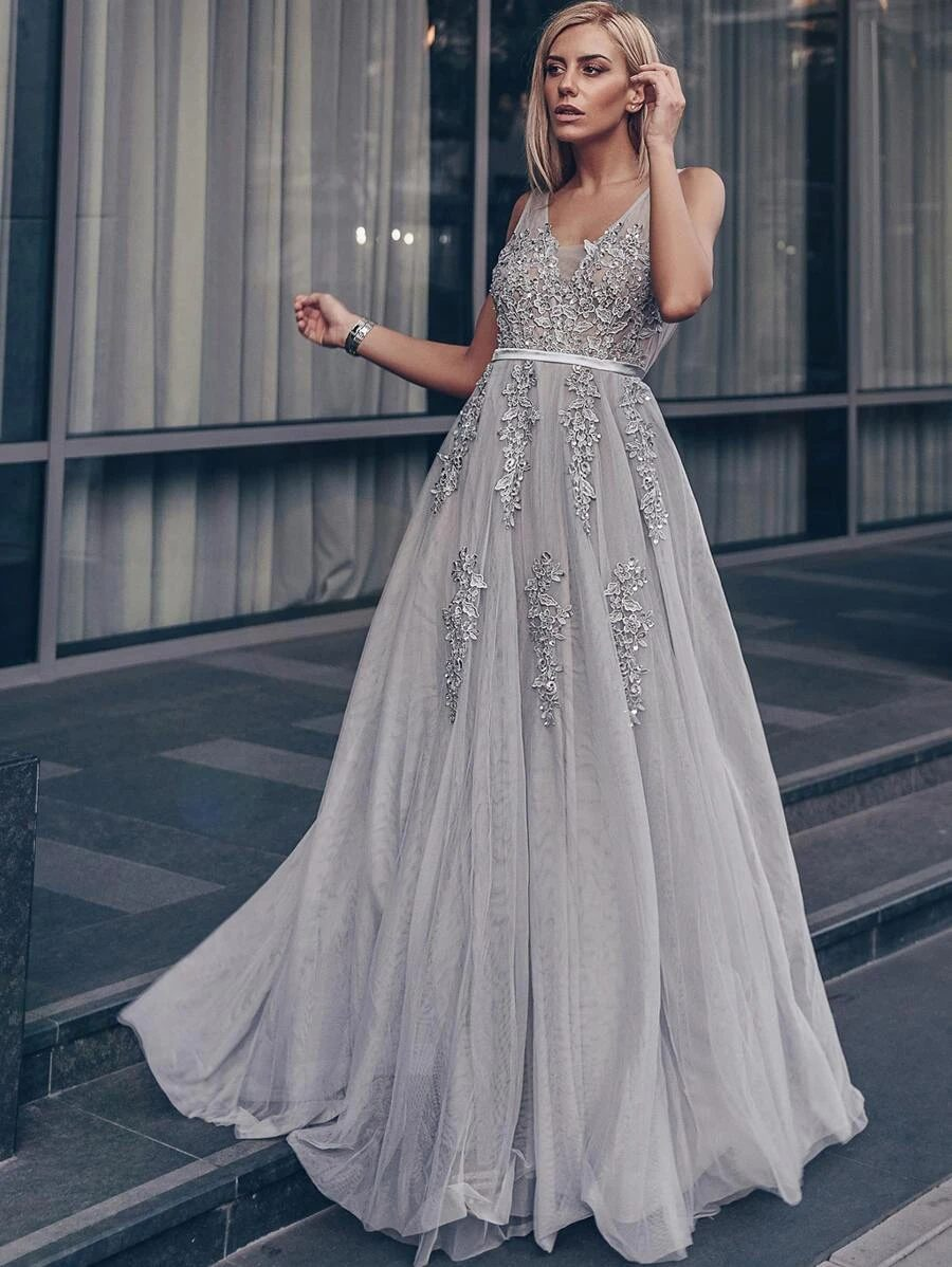 Long silver prom dress with sequins