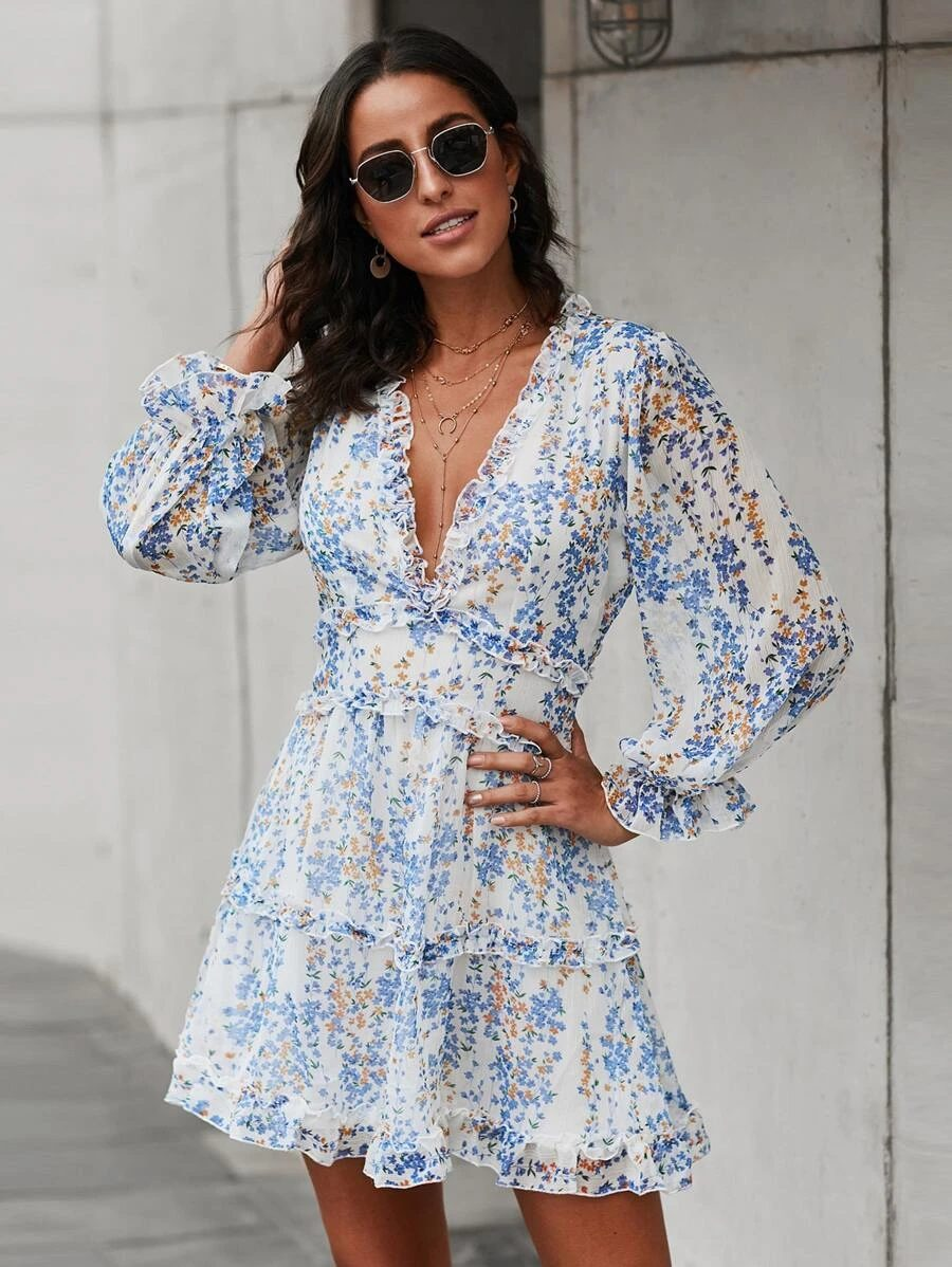 Short floral blue and white beach dress with ruffles and long sleeves