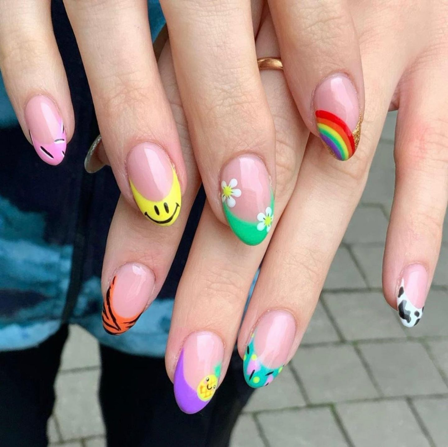 Colorful rainbow and smiley face nail art