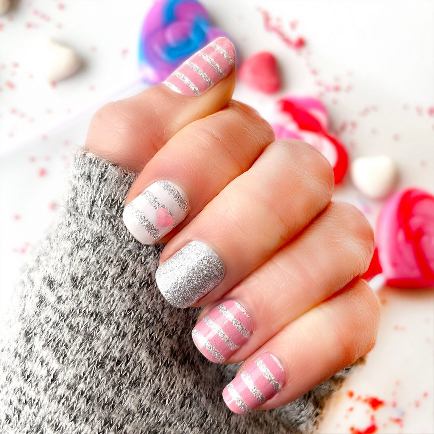 Cute silver and pink striped nails with glitter