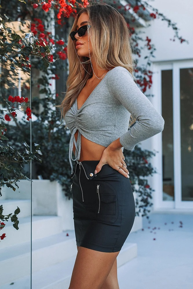 Black leather mini skirt look with crop top