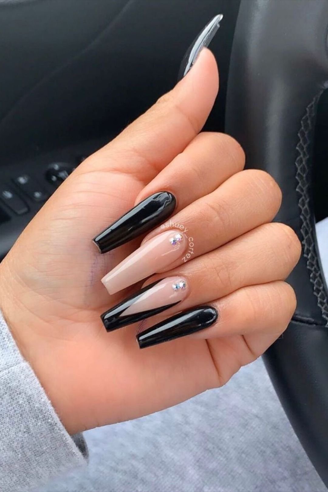 Long nude and black coffin nails with French tips
