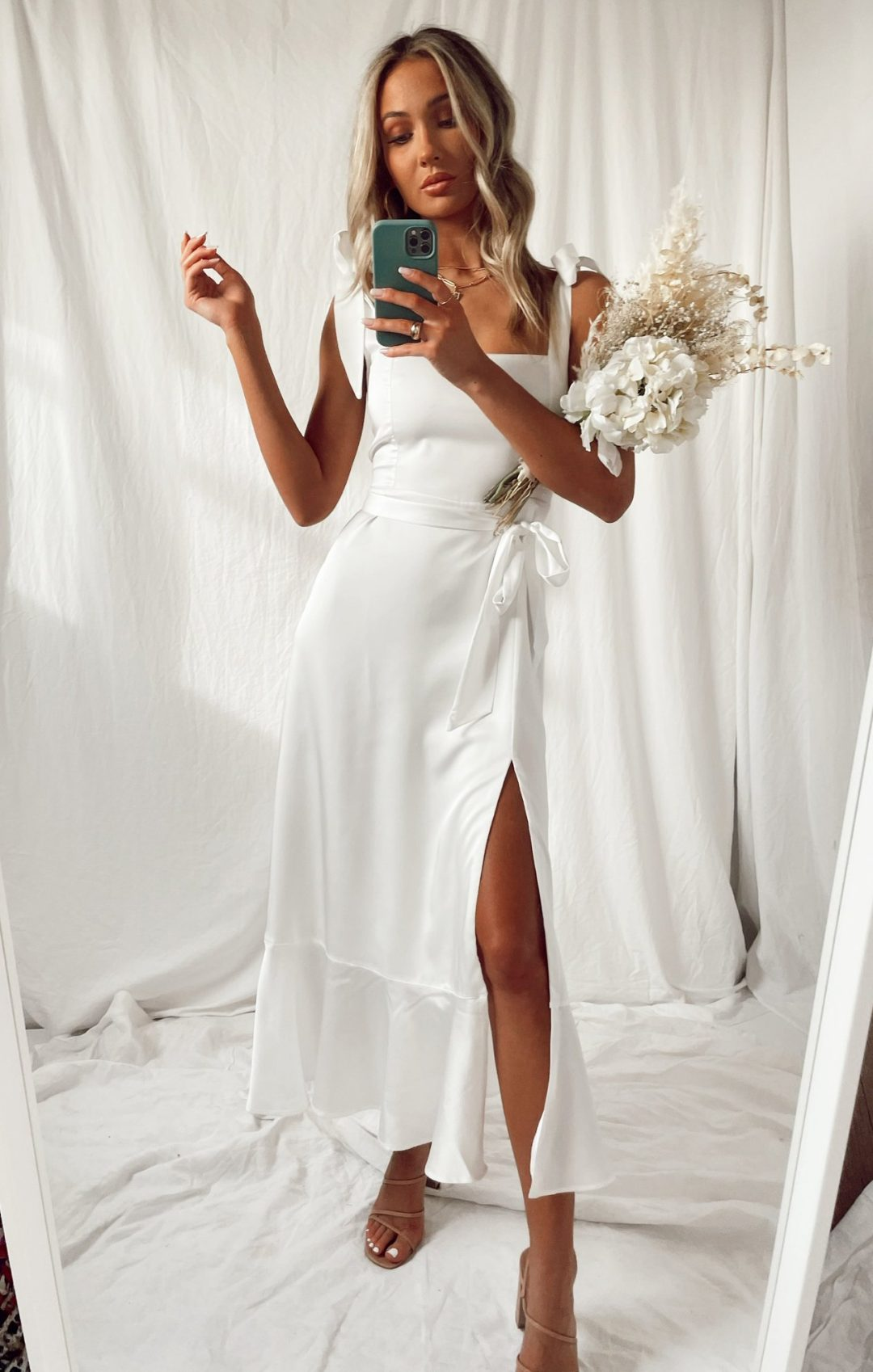 White satin graduation dress in midi length with a slit