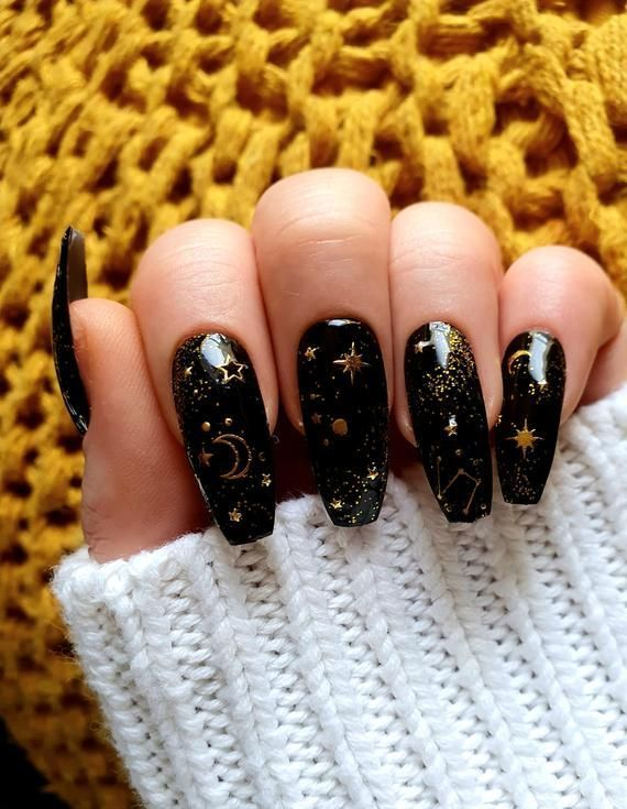 Cute celestial black nails with moon and stars