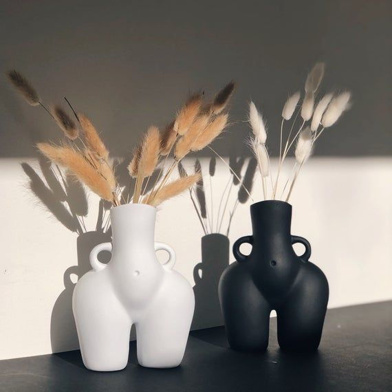 Black and white bum vases