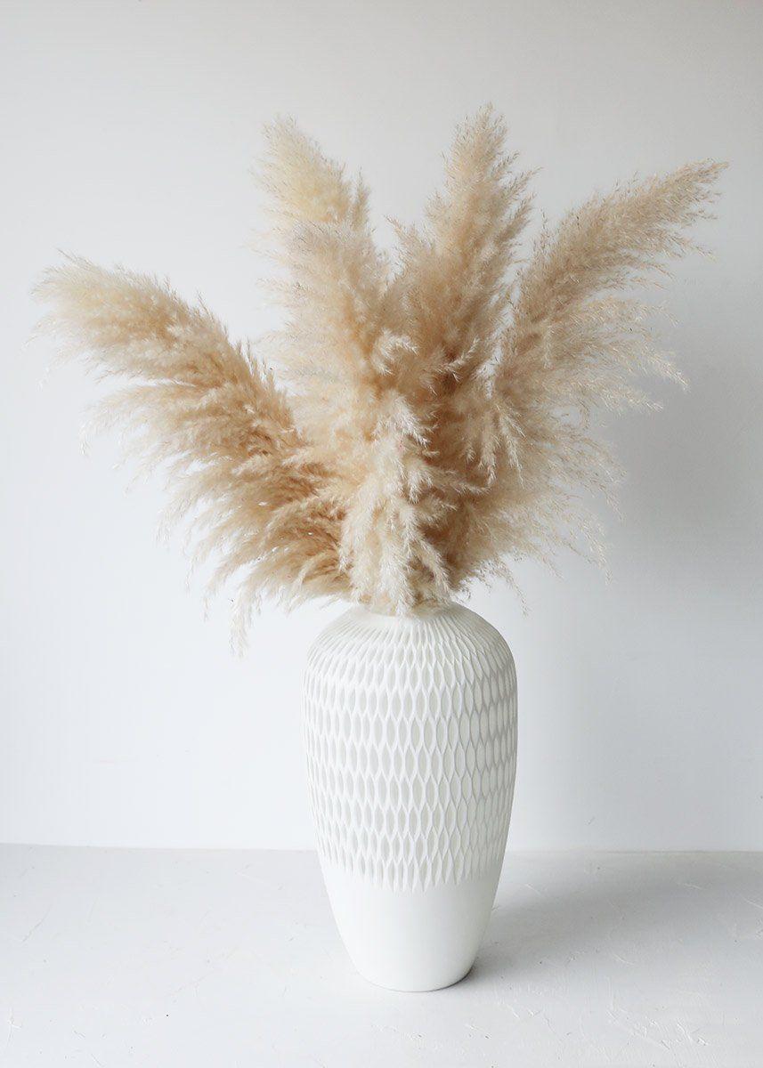 White ceramic vase with pampas grass