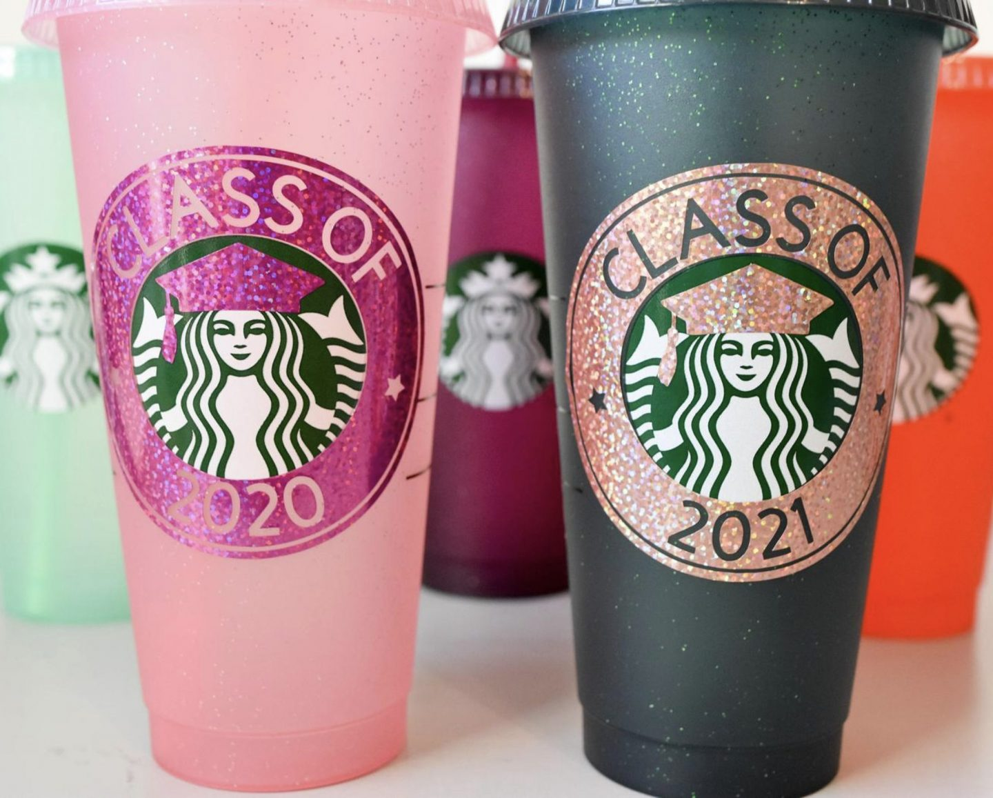 Customized pink and black Starbucks cups for graduation