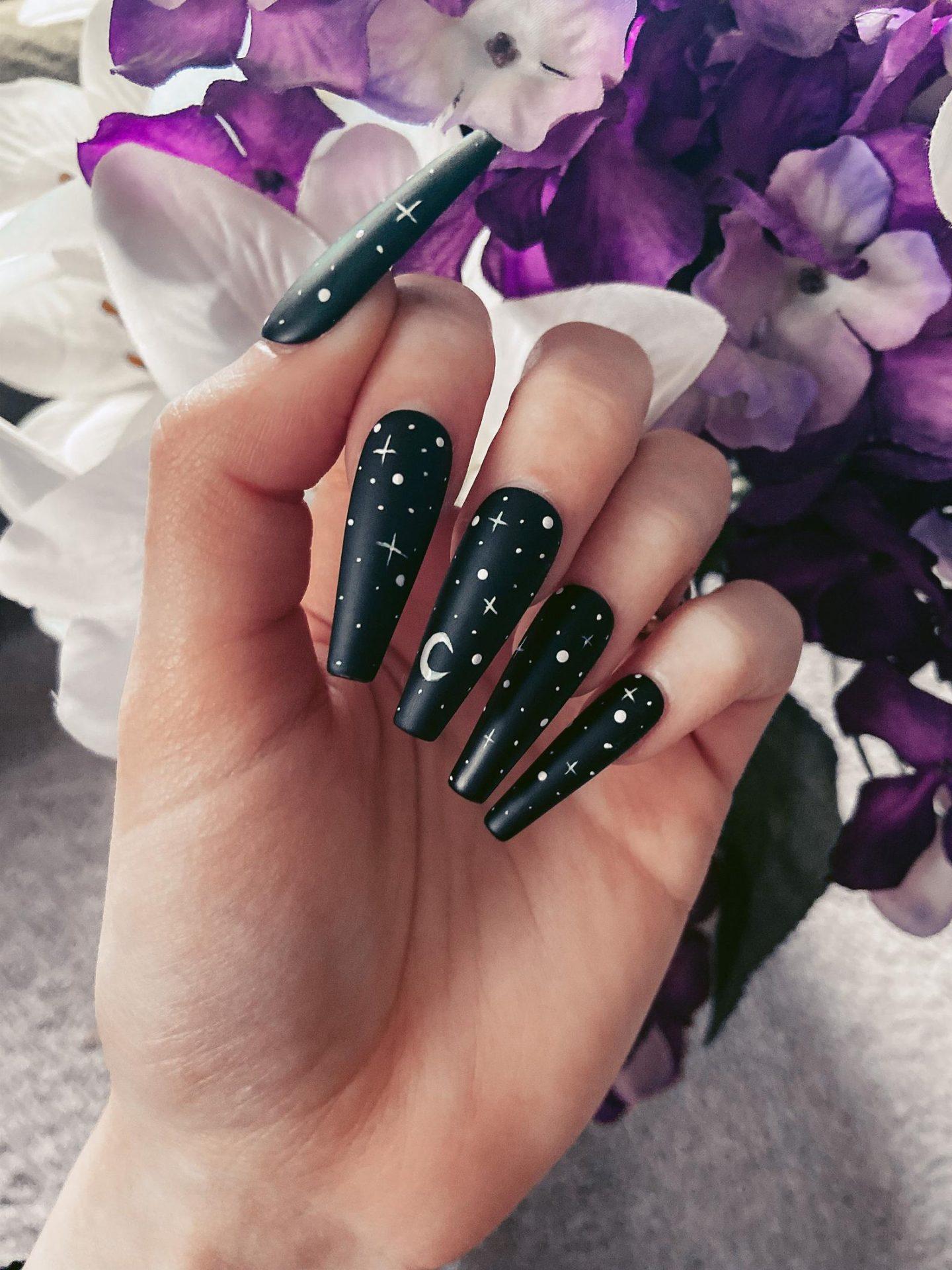 Black stars and moon nails