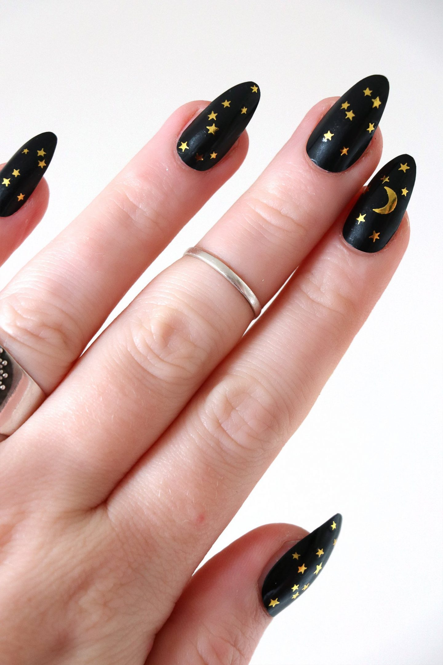 Cute black and gold nails with moon and star nail art
