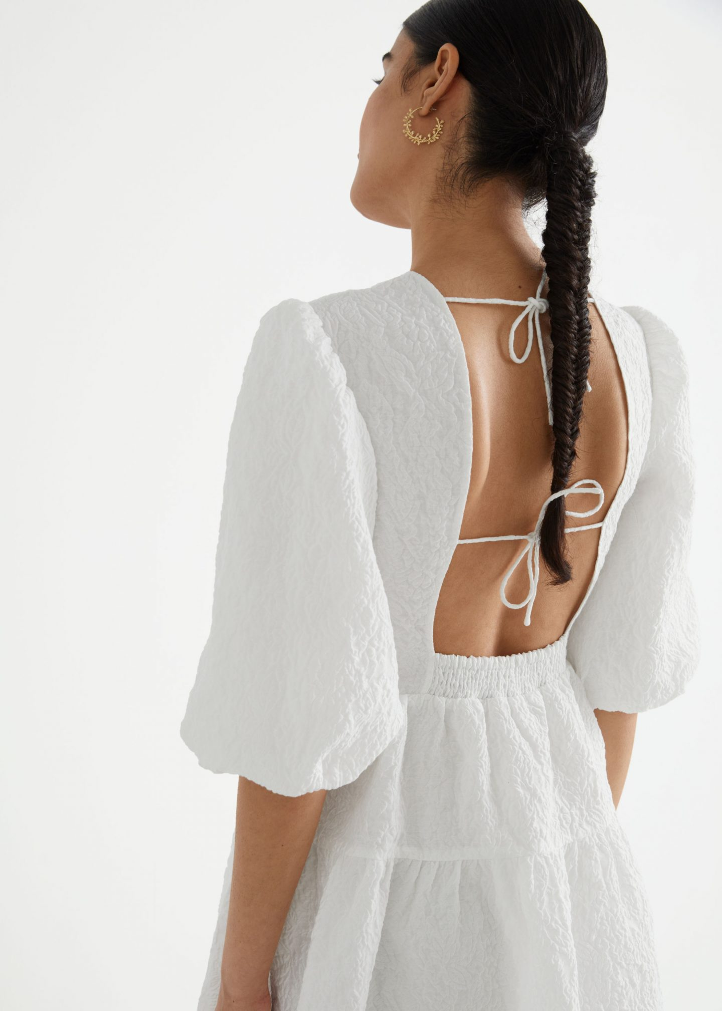 White backless dress with puffy sleeves