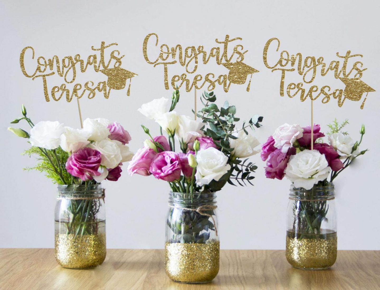 Gold graduation centerpieces with mason jars
