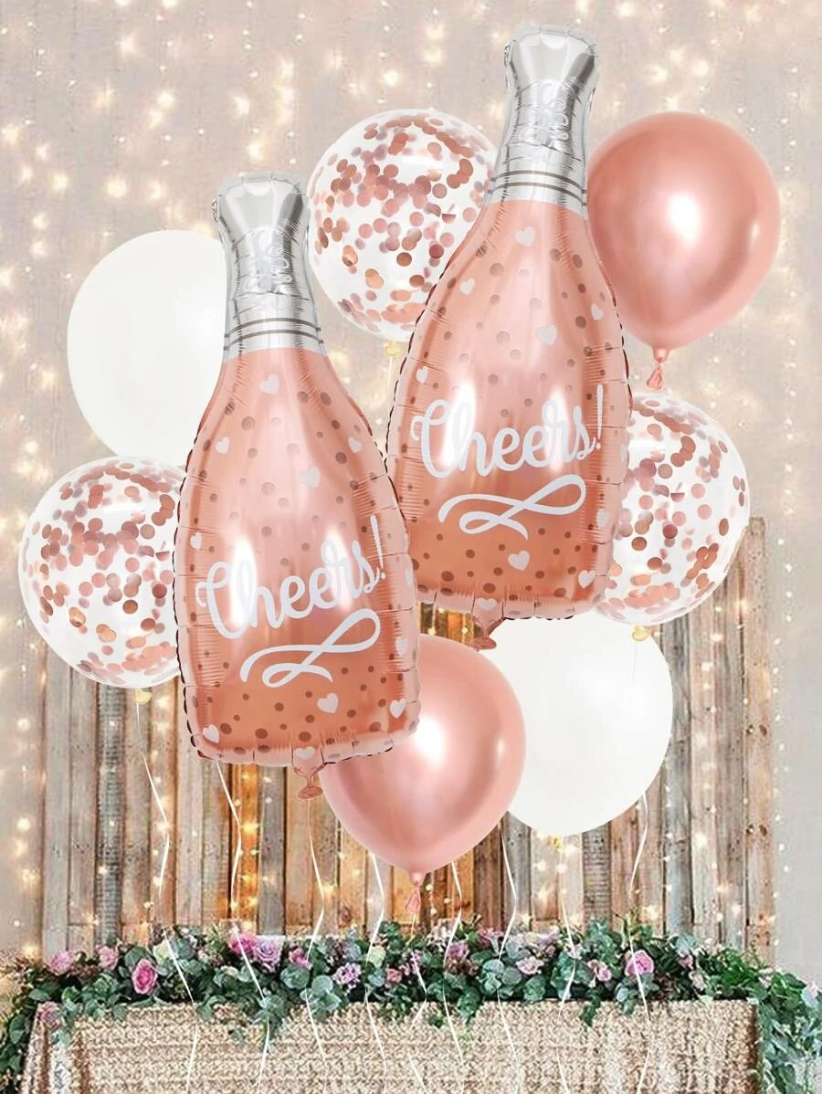 Pink graduation balloons with champagne bottle