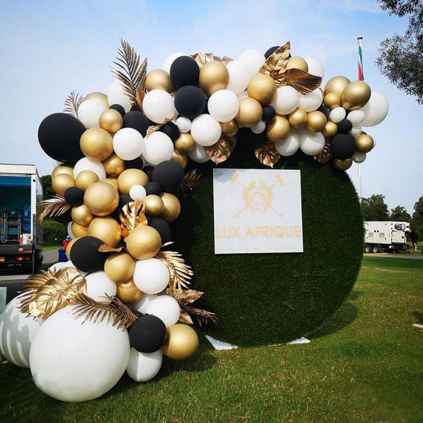 Black, gold and white graduation balloons