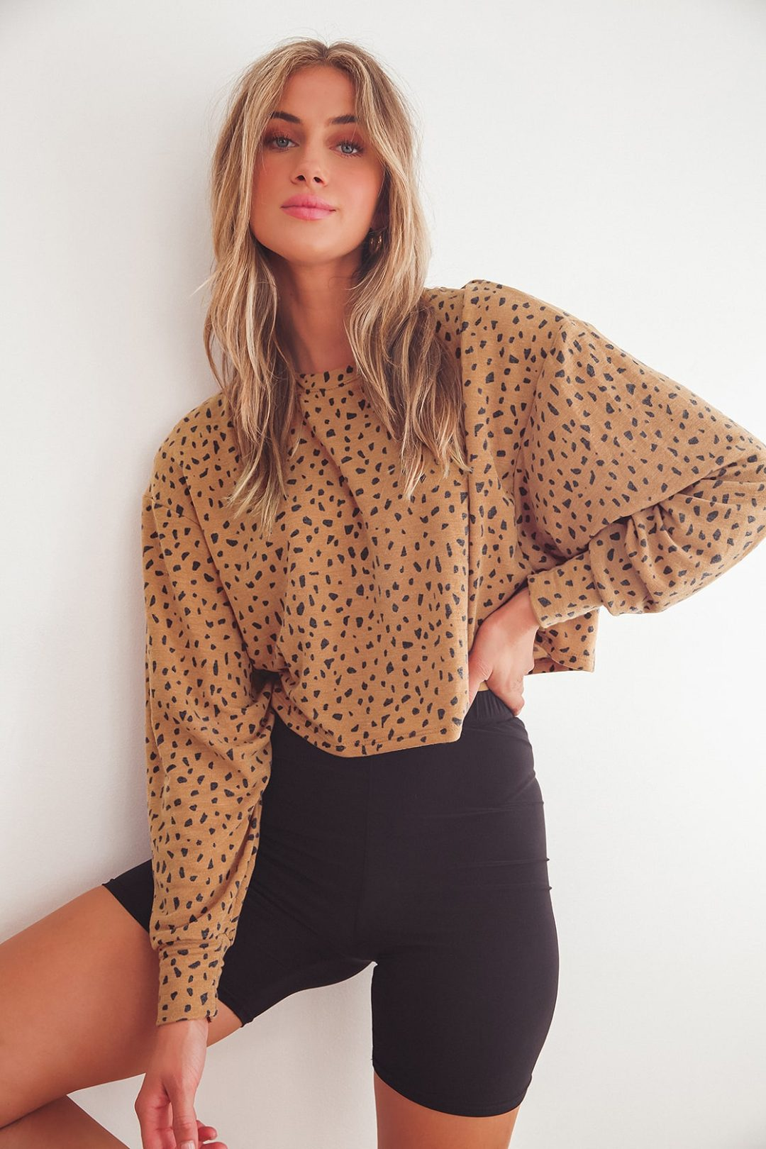 Leopard print sweatshirt outfit with bike shorts
