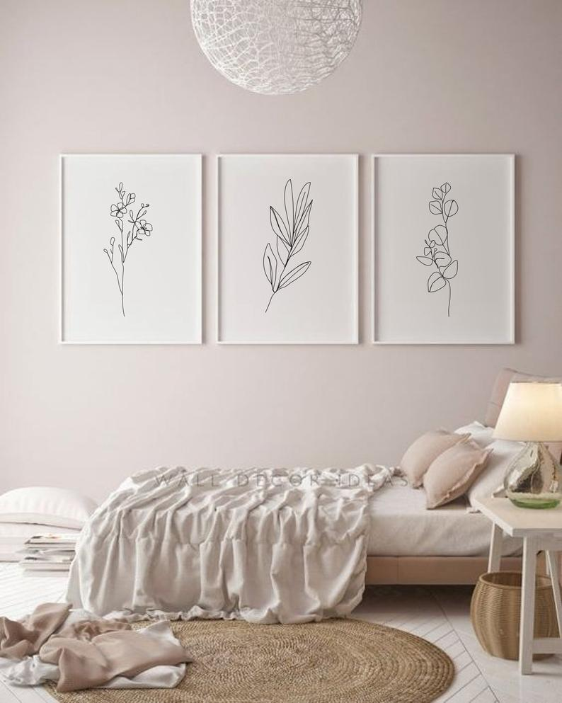 Minimalist and abstract wall art with lines, flowers and leaves