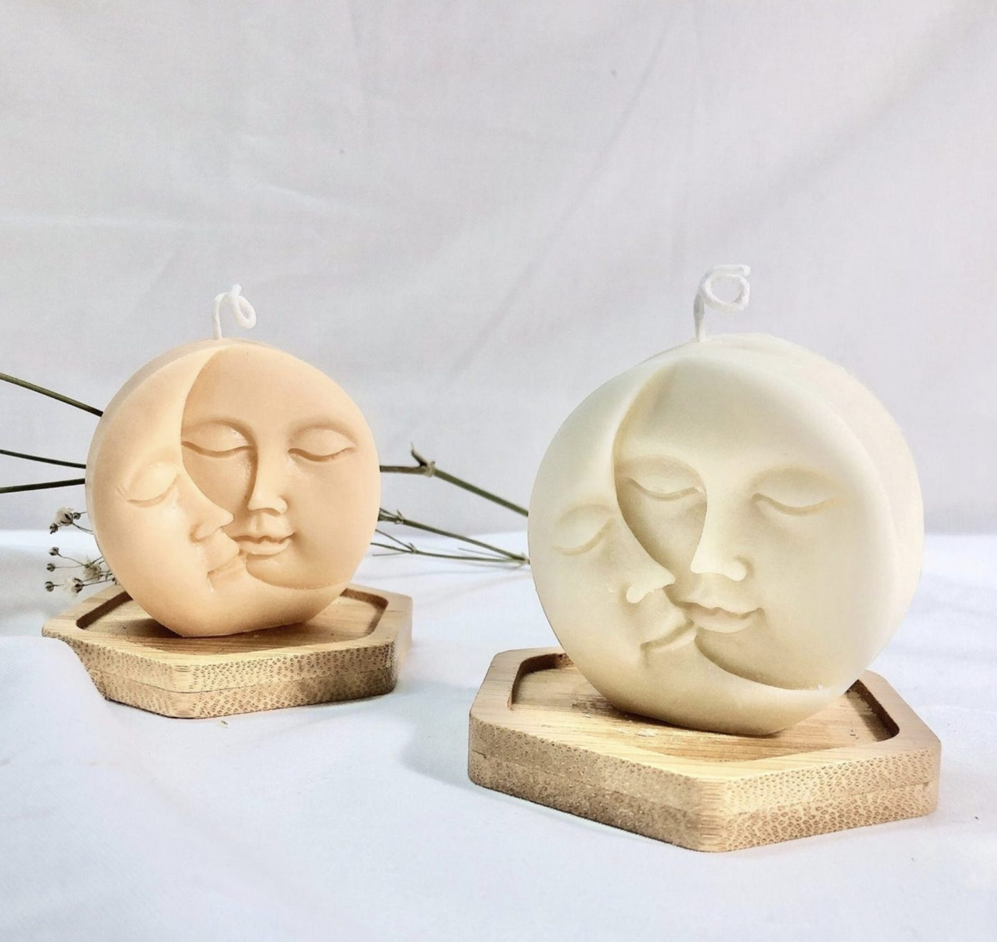 Trendy sculptural sun and moon candles