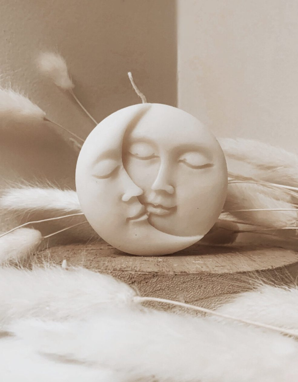 Cute sculptural moon and sun candle