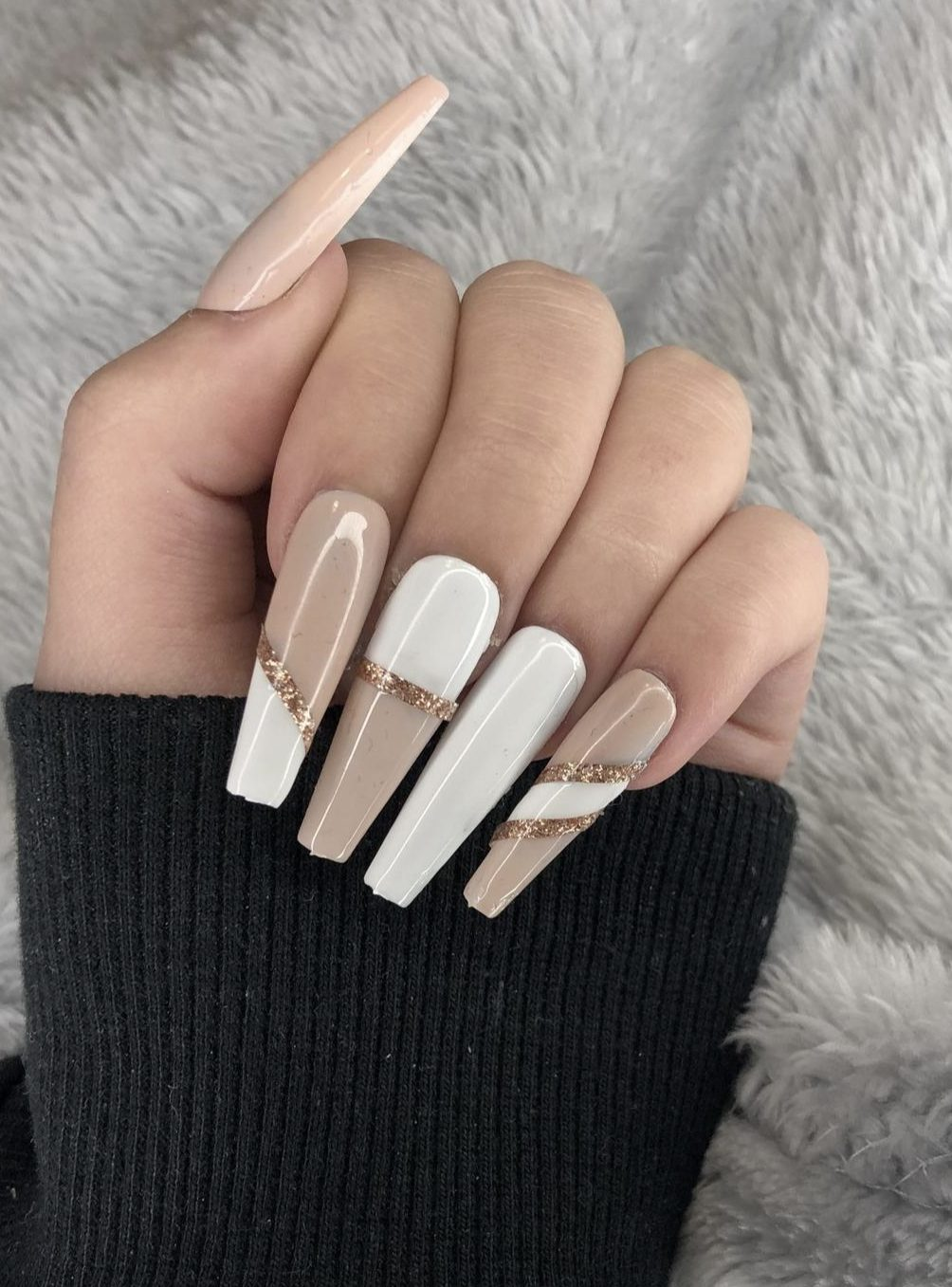 White and nude nails with gold glitter
