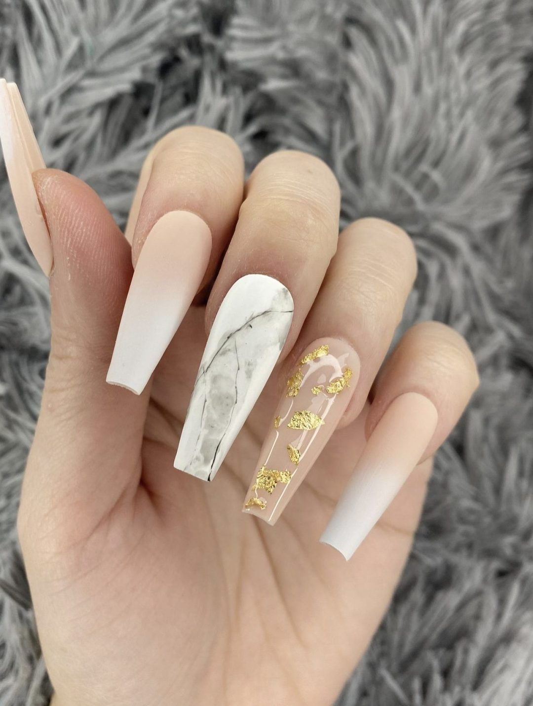 White and nude ombre nails with marble and gold foil nail art
