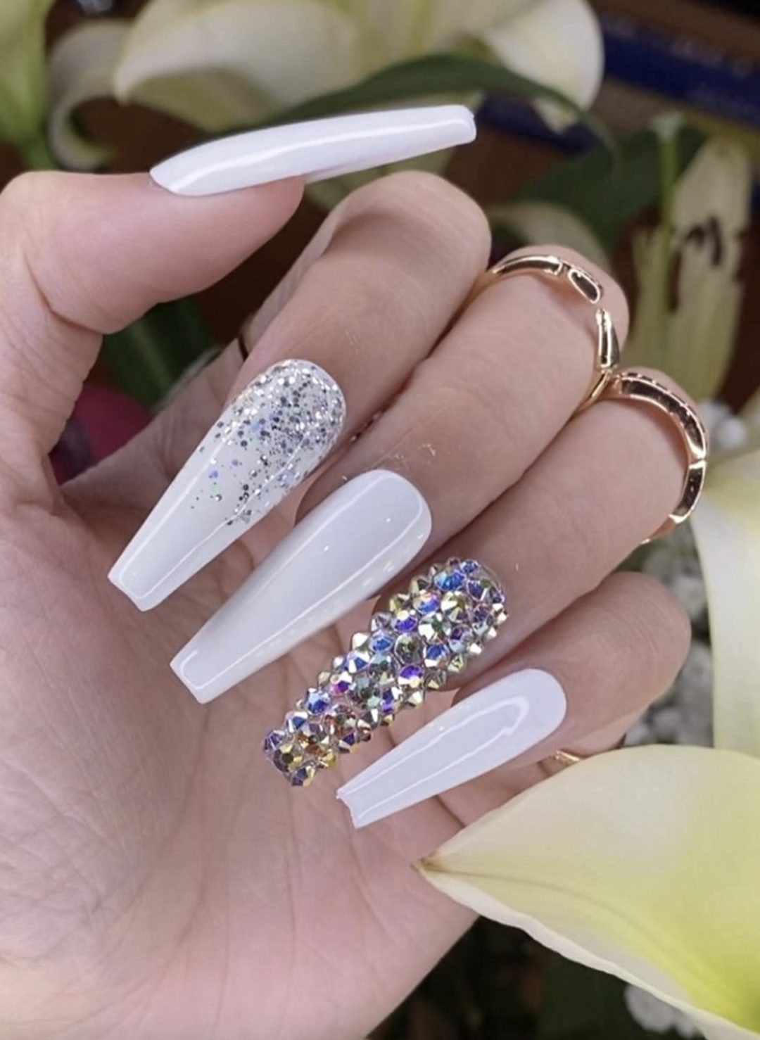 Long white coffin n ails with glitter and rhinestones