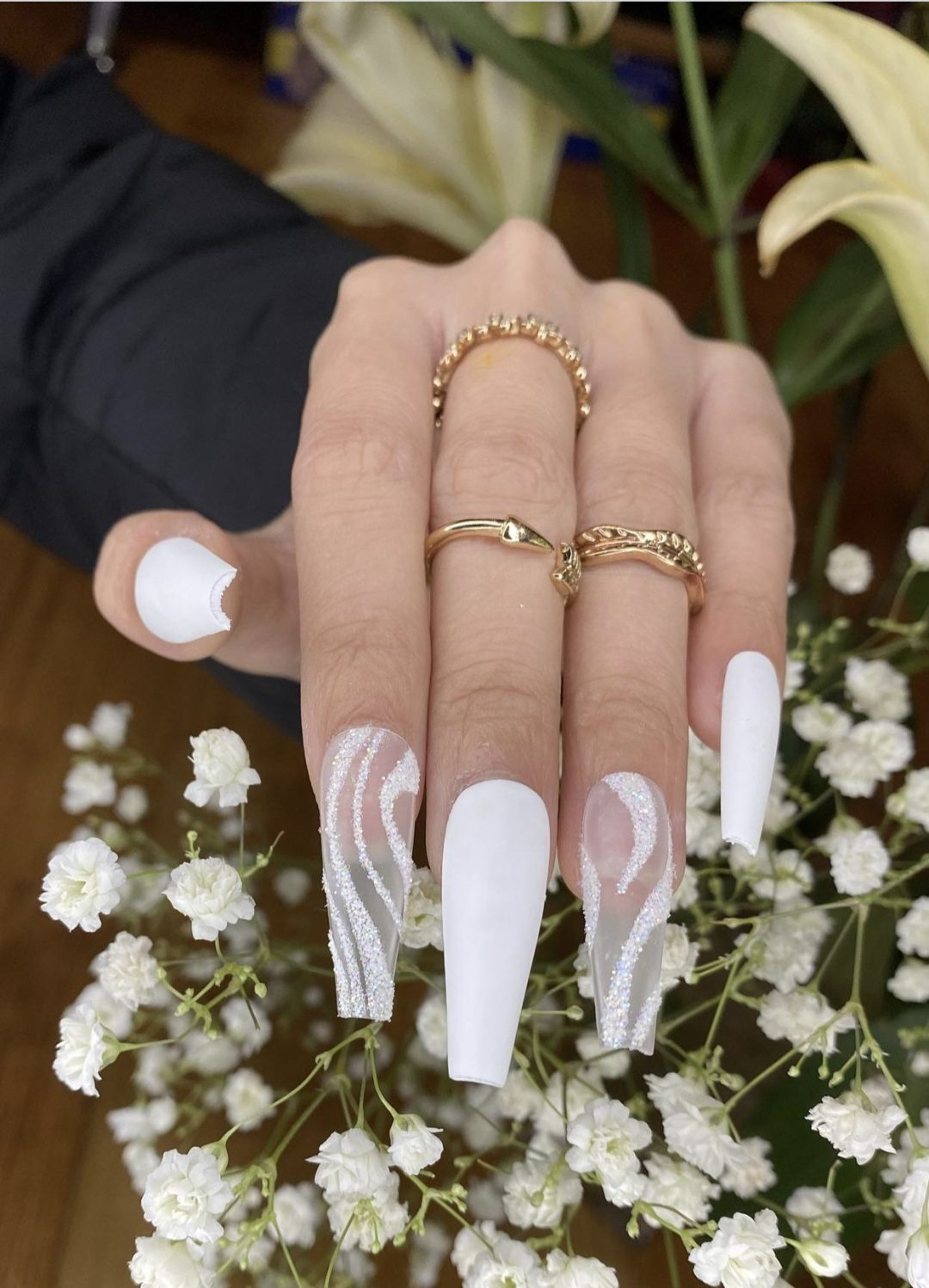 Long white coffin nails with transparent nails and swirls