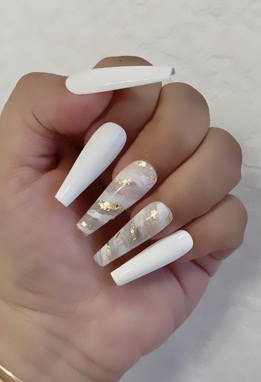 Long white acrylic coffin nails with marble and gold effect